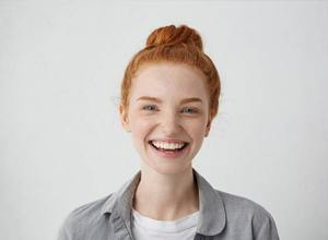smiling woman with straight teeth