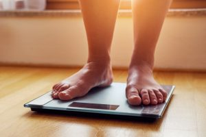 Feet on scale, illustrating connection between weight gain and sleep apnea